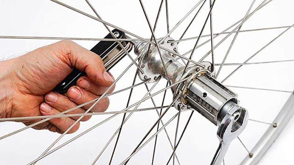 Lepas dan pasang adaptor pada sepeda